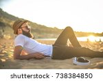 handsome guy lying down at the... | Shutterstock . vector #738384850