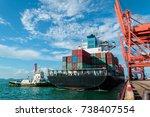 a large general cargo vessel... | Shutterstock . vector #738407554