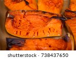 baked pumpkin pieces with... | Shutterstock . vector #738437650