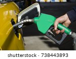 male hand holding gas pump one... | Shutterstock . vector #738443893