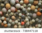 a wall of old weathered round... | Shutterstock . vector #738447118