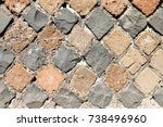 Small photo of Detail of perimeter wall of a house of ancient Rome with the layout of the brickwork that follows the technique of Opus Reticolatum