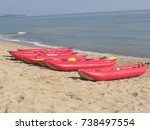 kayaks on the shore  | Shutterstock . vector #738497554