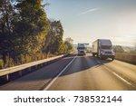 two semi trucks on the highway...   Shutterstock . vector #738532144