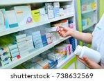 pharmacist holding bottle of... | Shutterstock . vector #738632569