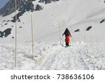 the trekker man with snow... | Shutterstock . vector #738636106