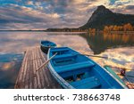 Stock photo beautiful autumn sunset landscape blue boats moored at wooden pier on the borovoe lake at burabay 738663748