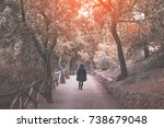 woman wearing a coat with hood... | Shutterstock . vector #738679048