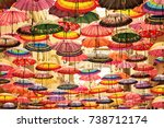 colorful umbrellas hanging | Shutterstock . vector #738712174