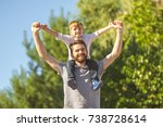 the son sit on the neck of... | Shutterstock . vector #738728614