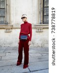 Small photo of MILAN - SEPTEMBER 21: Linda Tol with red velvet trousers before Max Mara fashion show, Milan Fashion Week street style on September 21, 2017 in Milan.
