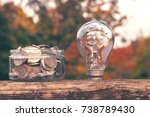 coins in the glass jar near the ... | Shutterstock . vector #738789430