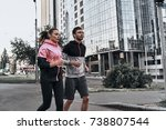 morning jog. young couple in... | Shutterstock . vector #738807544