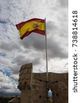 Small photo of Spanish flag waving on a tower of the Alcazar in Segovia