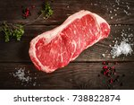 raw strip loin steak on white... | Shutterstock . vector #738822874