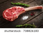 raw tomahawk steak on wooden... | Shutterstock . vector #738826183