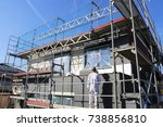 construction workers insulating ... | Shutterstock . vector #738856810