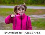 cute little girl holding a... | Shutterstock . vector #738867766