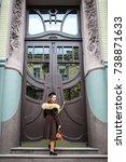 vintage girl with the old doors ... | Shutterstock . vector #738871633