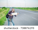 Smiling Woman Hitchhiker On The ...