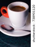 Small photo of A cup of coffee is americano on a dark background