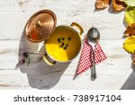pumpkin soup with seed in... | Shutterstock . vector #738917104