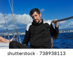man in black on the sailboard... | Shutterstock . vector #738938113