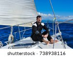 man in black on the sailboard... | Shutterstock . vector #738938116