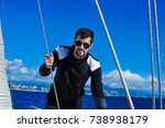 man in black on the yacht in... | Shutterstock . vector #738938179