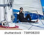 man in black on the yacht relax | Shutterstock . vector #738938203