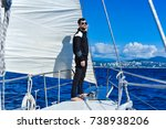 man in black on the sailboard... | Shutterstock . vector #738938206