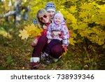 children in the park in autumn | Shutterstock . vector #738939346