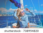 beautiful girl rests on a yacht | Shutterstock . vector #738954820