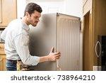 young man working as an... | Shutterstock . vector #738964210