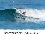 bodyboarder surfing ocean wave... | Shutterstock . vector #738965170
