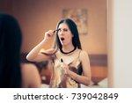 Woman Applying Mascara Getting...