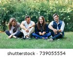 funny laughing friends sitting...   Shutterstock . vector #739055554