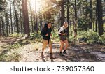 man and woman hikers trekking... | Shutterstock . vector #739057360