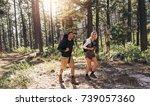 man and woman hikers trekking... | Shutterstock . vector #739057360
