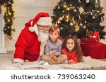 santa claus with kids indoors... | Shutterstock . vector #739063240