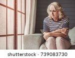 beautiful sad senior woman is... | Shutterstock . vector #739083730