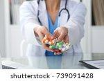 female doctor hand holding pack ...   Shutterstock . vector #739091428