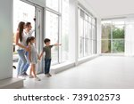 happy family entering new house | Shutterstock . vector #739102573