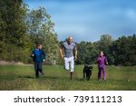 a family are running in the... | Shutterstock . vector #739111213