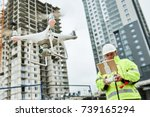drone operated by construction... | Shutterstock . vector #739165294