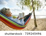 happy elderly woman enjoying in ... | Shutterstock . vector #739245496