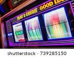 spinning slot machine drums.... | Shutterstock . vector #739285150