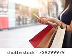 woman using smartphone and... | Shutterstock . vector #739299979