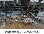excavator rakes a garbage heap... | Shutterstock . vector #739307923