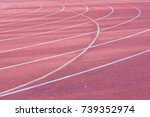 Small photo of All-weather red curving running track